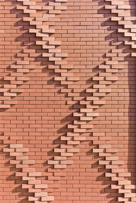 c pattern brick a message of unity literally programmed into a brick facade