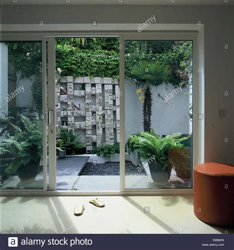 Garden Patio Doors View Through Glass Patio Doors To Courtyard Garden With Wall Stock Photo Royalty Free Image