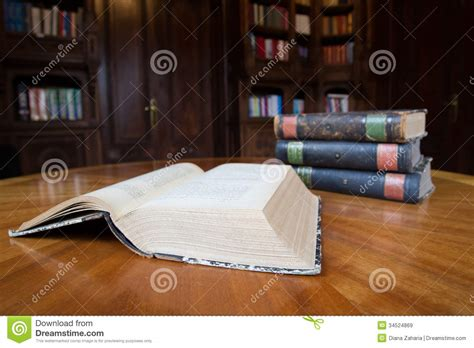 stacked books table l old books on a table royalty free stock images image