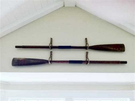 how to hang oars or paddles in an x shape the inspired susan snyder boat oars wall decor