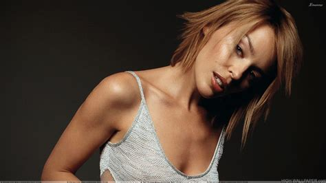 Best Quality Blouse Keylie minogue looking in grey top photoshoot n black background hd wallpaper