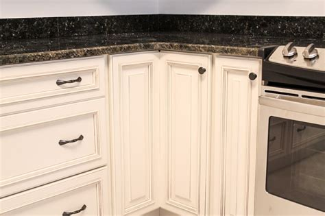 white cabinetry with hardware knob on lazy susan