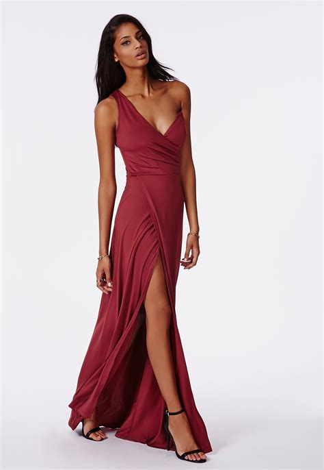Maxi Syari Cammelia Marron cbell wears dazzling purple split gown at the