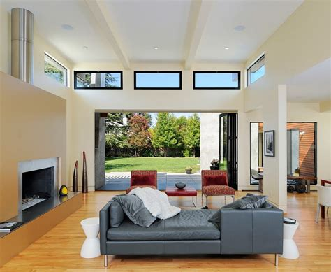 high windows bedroom modern with dark stained wood l listed ceiling fans