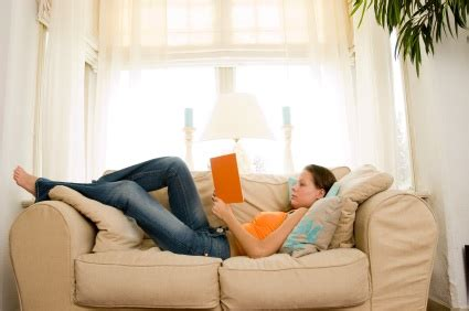 relaxing on the couch the wholey trinity 5 ways to reward yourself along your