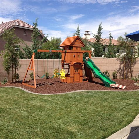 backyard playground set how to landscape under a swing set helpfulhowtos