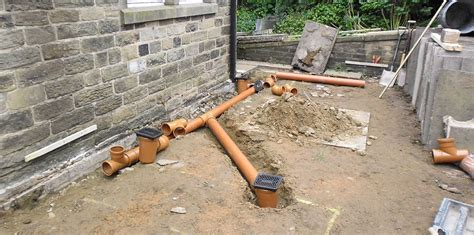 self build house extension drains planning sewage considerations building contractors london