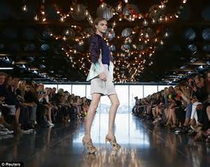 Showstopper cara delevingne opened the show wearing silk shorts and a