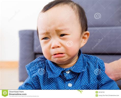 asiatische bilder asian baby boy feeling sad stock photos image 36192753