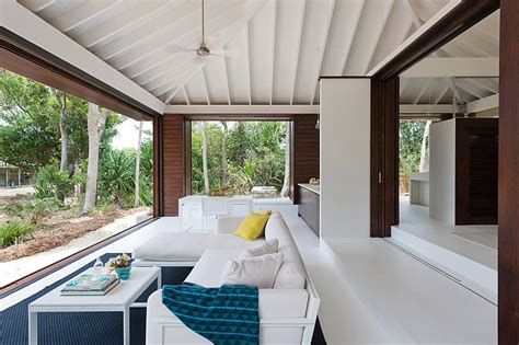 small tropical style house opens up to the world outside