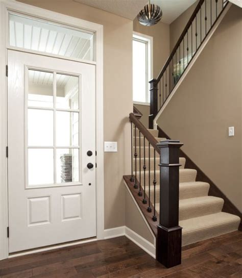 the neutral paint color goes great with wood and white trim valspar iced chocolate
