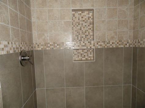 two shelf shower niche with tumbled mosaic banner running