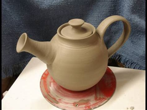 throwing a pot throwing making a clay pottery tea pot on the wheel how