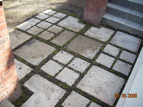Patio Pavers With Moss In Between Re Used Pavers And Moss Make A Small Patio Design Green