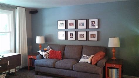 blue walls grey couch gray living room blue wall gray sofa orange accent