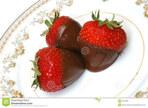 carbohydrates a strawberry chocolate dipped strawberries on plate closeup stock photo