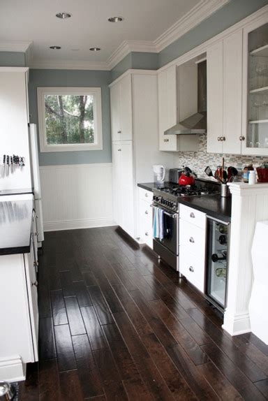 White Cabinets Black Countertops Gray Walls by Blue Gray Kitchen With Black Counter Tops And White Cabinets
