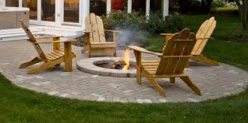 Patio with built in fire pit designed by archadeck of chicagoland