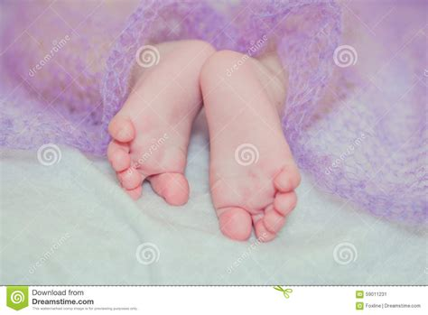 small baby bed feet small baby on a bed stock photo image 59011231