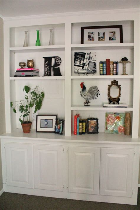 how to decorate bookshelves ten june my living room built in bookshelves are styled