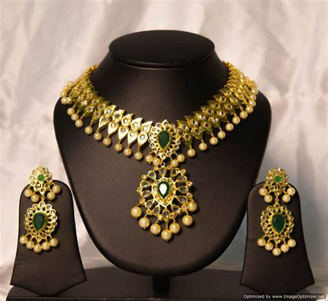 design is one online imitation uncut diamond necklace by chaahat jewellery