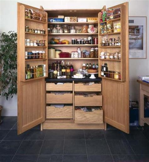 kitchen larder cabinets having freestanding pantry for solution to storage