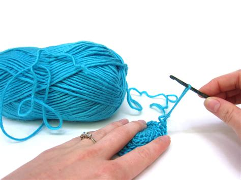 how to start a new skein of yarn when knitting save yourself a knot by working your yarn from both ends