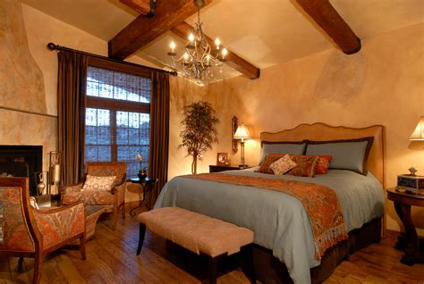 tuscan style bedrooms warm and charming tuscan style master bedroom with huge bed and a bench decorated with armchairs