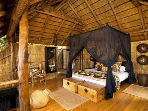 african style neutral bedroom  canopy bed hgtv