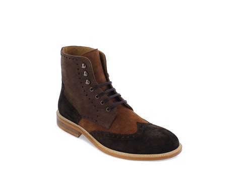 modern fiction medallion wingtip boots in brown for