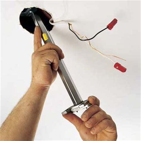 install the fan brace how to hang a chandelier this