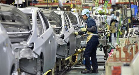 toyota line toyota halts output at production lines in in
