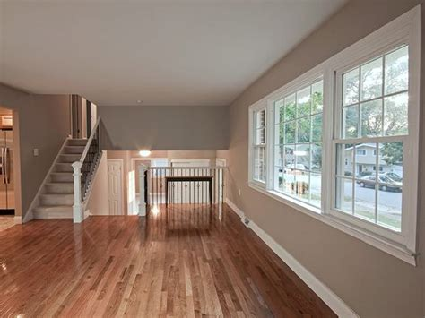 gleaming hardwood floors plus a gorgeous paint color in the living room of a renovated split