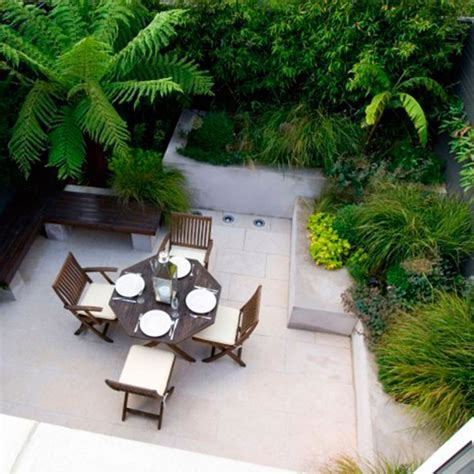how to make your backyard look good how to make your small garden look bigger good housekeeping
