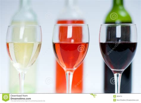 white and red rose wine glass red white and rose wine in glasses with bottles behind