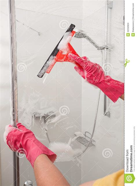 man cleaning bathroom cleaning with a window blade stock images image 32332824