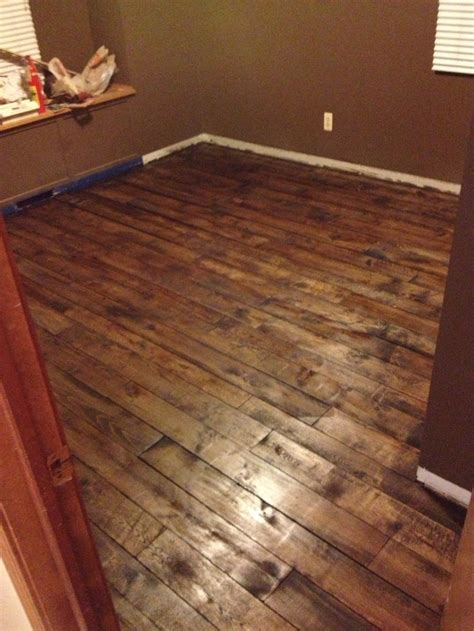 Pallet Board Flooring floor made of pallet crib boards drum sanded stained