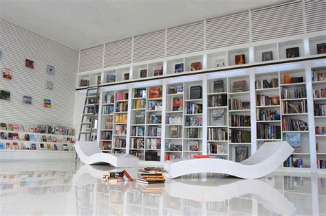 view in home office modern white shelving and themes