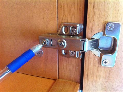 how to repair kitchen cabinet hinges how to adjust the alignment of cabinet doors