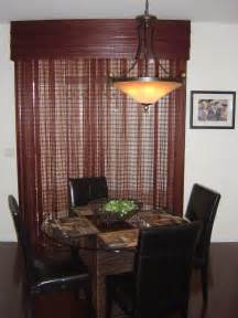 woven wood drapery a sliding glass door with a