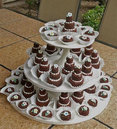 Mini brownie wedding cakes. Brownies instead of cake? Nice