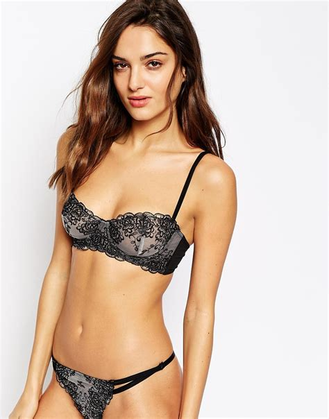Joan Set joan smalls strips to calvin kleins for