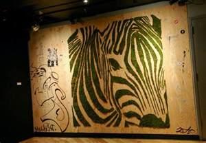Wall Murals Canada mosstika s moss graffiti fishes swim the streets of new