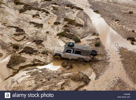 jeep stuck in mud aerial photograph of a jeep stuck in the mud of a flooded