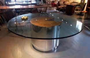 large burl and chrome dining table with glass top