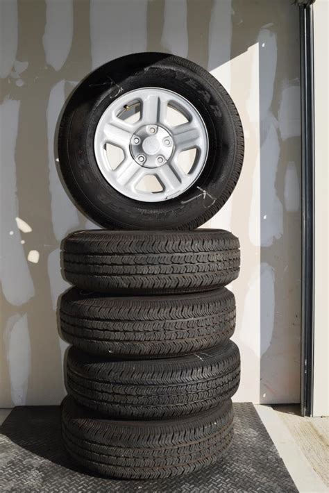 stock jeep wheels and tires jeep 16 inch oem wheels and tire package of 5 wheels tires
