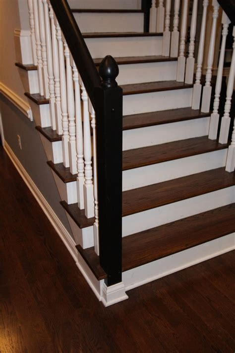 black banister white spindles jacobean stained floor stair treads with white spindles