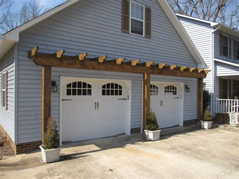 vinyl arbor over garage door landscape design