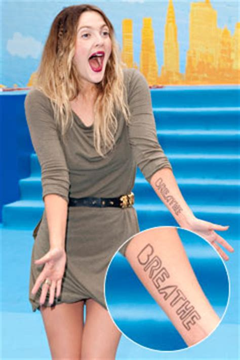 drew barrymore tattoos drew barrymore tattoos arm as reminder to meditate