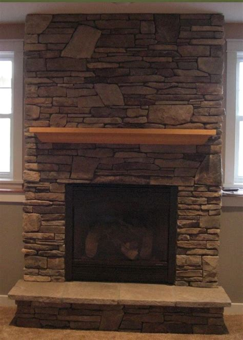 gas fireplace with cultured house decor